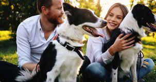 Couple playing with dogs Royalty Free Stock Photography