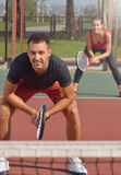 Couple playing doubles at the tennis court. Vertical image Stock Photo
