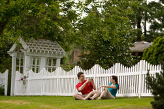 Couple Playing by Fence - horizontal stock image