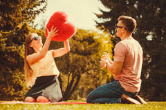 Couple playing games in park. Royalty Free Stock Image