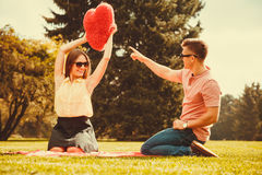 Couple playing games in park. Stock Photos