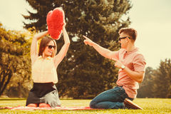 Couple playing games in park. Love romance dating relationship leisure concept. Couple playing games in park. Girl and her men passing heart spending time on stock images
