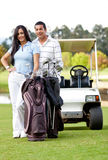 Couple playing golf Royalty Free Stock Image