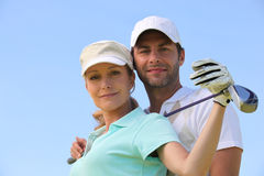 Couple playing golf. Man and women playing golf Stock Photo