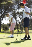 Couple playing golf Royalty Free Stock Images