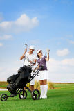 Couple playing golf at the club Stock Image