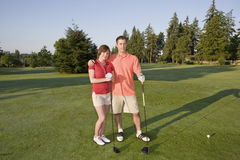 Couple Playing Golf On Course - Horizontal Royalty Free Stock Images