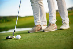 Couple playing golf Royalty Free Stock Photo