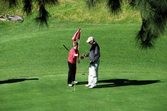 Couple playing golf, Spain. Stock Photography