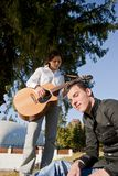 Couple playing guitar Royalty Free Stock Images