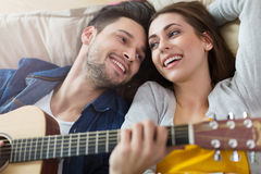 Couple playing guitar Stock Photography