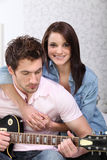 Couple playing a guitar Royalty Free Stock Images