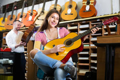 Couple playing the guitars Royalty Free Stock Image