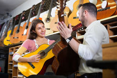 Couple playing the guitars Royalty Free Stock Photography