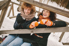 Couple playing harmonica together in winter outdoors Royalty Free Stock Photos