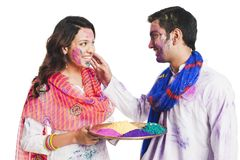 Couple playing holi Stock Photo