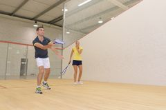 Couple playing in indoor tennis court royalty free stock photos