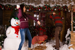 Couple Playing Inside the House with Cotton Snow Stock Photography