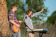 Couple playing music Royalty Free Stock Image