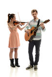 Couple playing music Stock Photos
