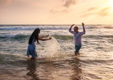 Couple playing in the ocean royalty free stock images