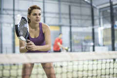 Couple playing paddle tennis in court with racket and balls Stock Photography