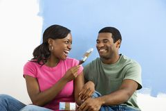 Couple playing with  paint brushes. Stock Photos