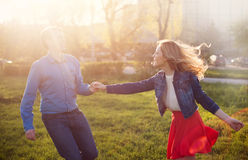Couple playing in the park at sunset Royalty Free Stock Image