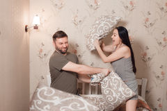 Couple playing with pillows Royalty Free Stock Image
