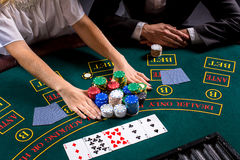couple playing poker at the table Royalty Free Stock Photo