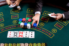 couple playing poker at the table Stock Images