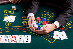 couple playing poker at the table Royalty Free Stock Photos