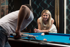 Couple Playing Pool At The Bar Stock Image