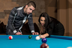 Couple Playing Pool At The Bar Stock Photography