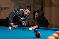 Couple Playing Pool At The Bar Stock Photo