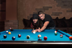 Couple Playing Pool At The Bar Royalty Free Stock Image
