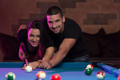 Couple Playing Pool At The Bar Royalty Free Stock Photo