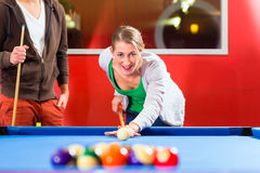Couple playing pool billiard game Royalty Free Stock Photo