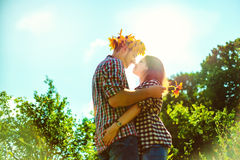 Couple playing romantic game.  Hugs against a sky Stock Photo
