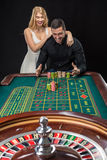 Couple playing roulette wins at the casino. Addiction to the gambling Royalty Free Stock Image