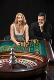 Couple playing roulette wins at the casino. Royalty Free Stock Photography