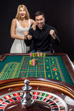 Couple playing roulette wins at the casino. Addiction to the gambling Stock Image