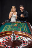 Couple playing roulette wins at the casino. Stock Image
