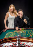 Couple playing roulette wins at the casino. Addiction to the gambling Royalty Free Stock Photos