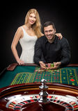 Couple playing roulette wins at the casino. Addiction to the gambling Stock Images