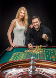 Couple playing roulette wins at the casino. Addiction to the gambling Stock Photo