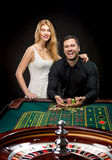 Couple playing roulette wins at the casino. Addiction to the gambling Stock Photography