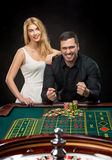 Couple playing roulette wins at the casino. Addiction to the gambling Royalty Free Stock Photography