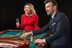 Couple playing roulette wins at the casino. Royalty Free Stock Image