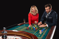 Couple playing roulette wins at the casino. Stock Photo